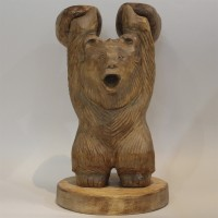 Wooden bear figure with kettlebells