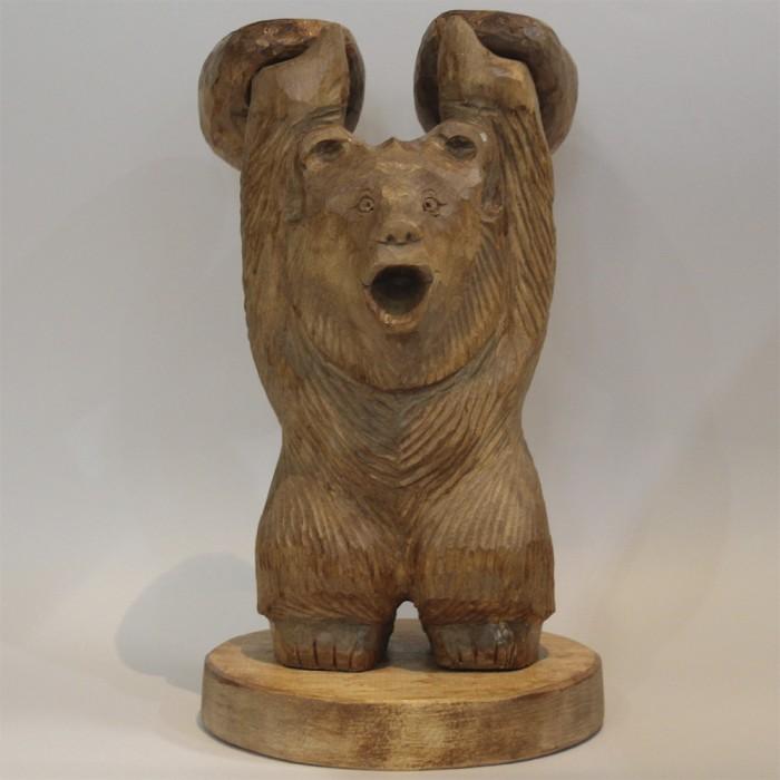 Wooden bear figure with kettlebells